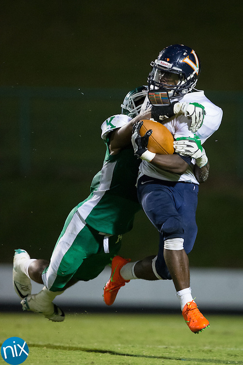 Markilius Williams (3) of the Vance Cougars is tackled for a 7-yard loss by Steven Howie (2) of the A.L. Brown Wonders during first half action at A.L. Brown High School on September 30, 2016 in Kannapolis, North Carolina.  The Wonders defeated the Cougars 24-21.  (Brian Westerholt/Special to the Tribune)