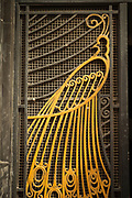 Wrought iron peacock on art deco door in Casablanca, Morocco