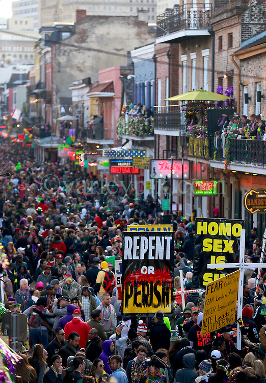 17 Feb 2015. New Orleans, Louisiana.<br /> Fat Tuesday. Mardi Gras Day. Crowds pack Bourbon Street as the sun goes down.<br /> Photo; Charlie Varley/varleypix.com