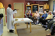Rev. Paula Maina Waithaka ends a mass with residents at The Abbington of Glenview healthcare residence on Wednesday, August 20th. Waithaka is Pastor at St. Catherine Laboure in Glenview. August 20th, 2014 l Brian J. Morowczynski-ViaPhotos<br /> <br /> For use in a single edition of Catholic New World Publications, Archdiocese of Chicago. Further use and/or distribution may be negotiated separately. <br /> <br /> Contact ViaPhotos at 708-602-0449 or email brian@viaphotos.com.