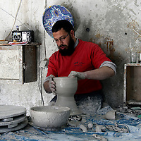 Africa, Morocco, Fes. Moroccan artisan spinning clay bowl.