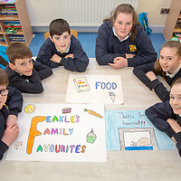 Ethan Punch, Eddy Moses, Tom Moloney, Abby Callaghan, Niamh Liddane and Molly Kelleher working on their posters for their Jessies project 'Feakle Family Favourites' Cookbook