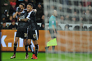 Riyad Mahrez (26) of Leicester city celebrates with Danny Simpson after he scores his teams 3rd goal to complete his hat-trick. Barclays Premier league match, Swansea city v Leicester city at the Liberty Stadium in Swansea, South Wales on Saturday 5th December 2015.<br /> pic by  Andrew Orchard, Andrew Orchard sports photography.