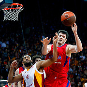 Galatasaray MP's Joshua Ian Shipp (L) and CSKA Moscow's Darjus Lavrinovic (R) during their Euroleague Top 16 basketball match Galatasaray MP between CSKA Moscow at the Abdi Ipekci Arena in Istanbul at Turkey on Thursday, February, 09, 2012. Photo by TURKPIX