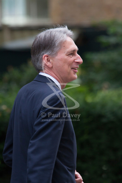Downing Street, London July 15th 2014. New Foreign Secretary Phillip Hammond leaves 10 Downing Street following his appointment to his new portfolio, replacing William Hague.
