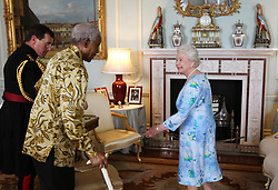 Britain's Queen Elizabeth II meets former South African President Nelson Mandela at Buckingham Palace, London.