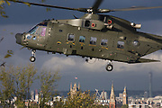 An AgustaWestland AW101 makes a controlled landing in a south London public park below. The houses of Parliament are in the distance. After circling for 5 minutes in windy conditions and hovered metres above the ground n Ruskin Park, south London. Autumn leaves flew in all directions in this regular landing point for the Royal Air Force and army. The RAF frequently make reconnaissance flights to this Lambeth open space for crew training purposes. The Merlin is a medium-lift helicopter used in both military and civil applications. It was developed by joint venture between Westland Helicopters in the UK and Agusta in Italy and was named the EH101 until 2007.  .
