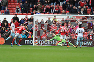 Nottingham Forest's Jamie Paterson shoots and scores his sides 4th goal. FA Cup with Budweiser, 3rd round, Nottingham Forest v West Ham Utd match at the City Ground in Nottingham, England on Sunday 5th Jan 2014.<br /> pic by Andrew Orchard, Andrew Orchard sports photography.