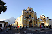 Volcan de Agua, the Volcano of Water, 3766m, dominates views to the south of Antigua Guatemala. Here it is the background to the church of San Pedro. Antigua Guatemala, Republic of Guatemala. 03Mar14