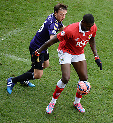 Bristol City's Jay Emmanuel-Thomas shields the ball from West Ham's Mark Noble - Photo mandatory by-line: Alex James/JMP - Mobile: 07966 386802 - 25/01/2015 - SPORT - Football - Bristol - Ashton Gate - Bristol City v West Ham United - FA Cup Fourth Round
