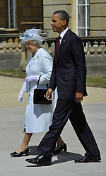 President of the United States Barack Obama and Queen Elizabeth II walk in the garden of Buckingham Palace in London, on the first day of President Obama's three-day state visit to the UK.
