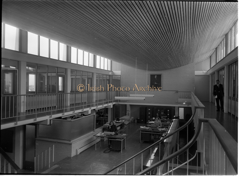 04/06/1964<br /> 06/04/1964<br /> 04 June 1964<br /> Sisk's new offices and premises at Naas Road, Clondalkin, Dublin. View of some of the office workspace. Painting of company founder John Sisk on wall.