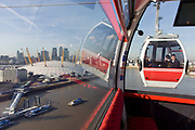 The southbound view from a gondola on a journey over the River Thames on the Emirates Cable Car, from Royal Docks towards the o2 arena on the Greenwich Peninsular. There are 34 gondolas, each with a maximum capacity of 10 passengers. The Emirates Air Line (also known as the Thames cable car) is a cable car link across the River Thames in London built with sponsorship from the airline Emirates. The service opened on 28 June 2012 and is operated by Transport for London. The service, announced in July 2010 and estimated to cost £60 million, comprises a 1-kilometre (0.62 mi) gondola line that crosses the Thames from the Greenwich Peninsula to the Royal Docks.