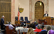 """Merrick, New York, USA. January 21, 2015. JANE BRADEN-GOLAY, from Schaffhausen, Switzerland, and President of the European Union of Jewish Students, is speaking from pulpit to Rabbi CHARLES A. KLEIN, at left, at the Merrick Jewish Centre the night before she is scheduled to address - upon the invitation of Ambassador Samantha Power, U.S. Permanent Representative to the United Nations - ambassadors and civil rights leaders at Rep. Power's residence, after the first United Nations General Assembly meeting on rise of anti-Semitic violence worldwide. When asked about recent terror attacks in France (against French satirical weekly newspaper Charlie Hebdo in Paris), Braden-Golay said, """"It's all still so very fresh.... Europe is in a shock state right now"""" but that she hoped in weeks to come """"for all of us to take responsibility for creating a Europe that doesn't give room to this sort of terror again."""" AJC Long Island and Merrick Jewish Centre presented the event """"Terrorism in France - Where Do We Go From Here?"""" with speaker Braden-Golay, a senior at the University of Zurich."""