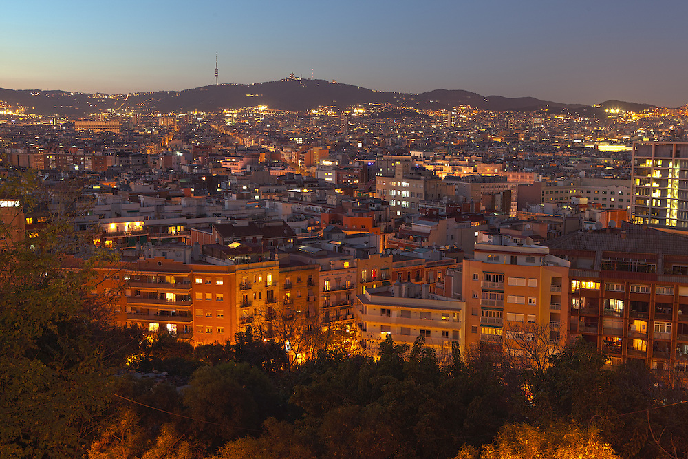 The city of Barcelona, with the Sant Antoni and Poble Sec neighbourhoods in the foreground, seen at sunset from the Montjuic hills. Barcelona, Catalonia, Spain.