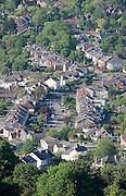 Suburban houses and tree lined road at the south edge of Cheltenham Spa Town, Gloucestershire. Aerial view seen from Leckhampton Hill