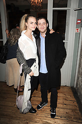 CARA DELEVINGNE and TYRONE WOOD at a party to celebrate the 1st anniversary of Alice Temperley's label held at Paradise, Kensal Green, London W10 on 25th November 2010.