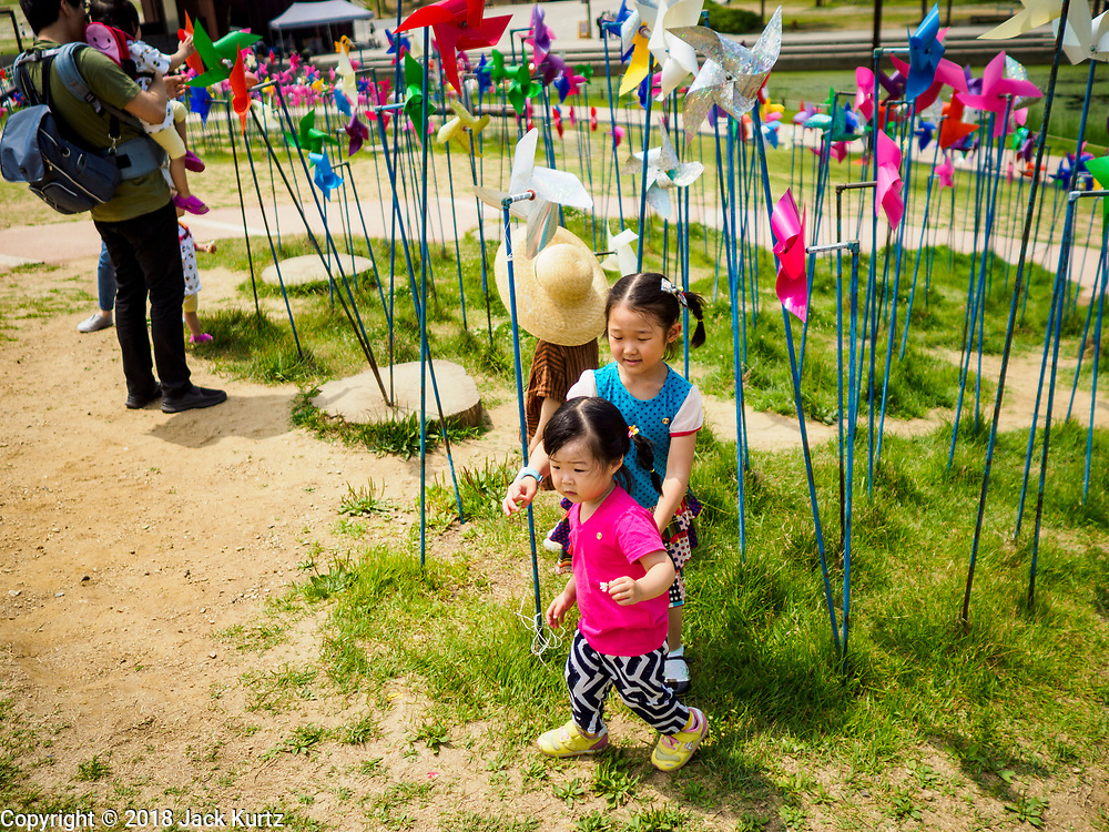 09 JUNE 2018 - IMJINGAK, PAJU, SOUTH KOREA: A South Korean girls play in the park on the South Korean side of the Korean DMZ in Imjingak. Imjingak is a park and greenspace in South Korea that is farthest north most people can go without military authorization. The park is on the south bank of Imjin River, which separates South Korea from North Korea and is close the industrial park in Kaesong, North Korea that South and North Korea have jointly operated.     PHOTO BY JACK KURTZ