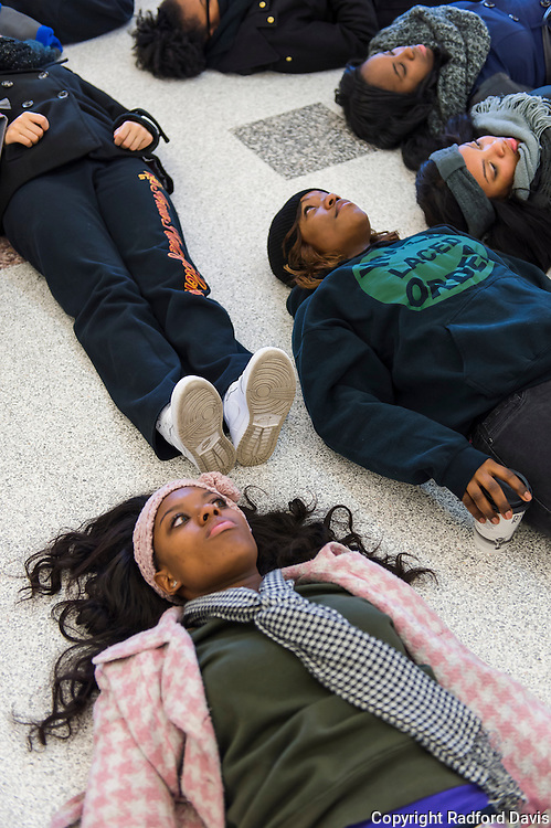 Student protesters at Iowa State University lay silent on the library floor for 4.5 minutes to speak out against discrimination and the recent deaths of 2 black men at the hands of police in Missouri and NY City.