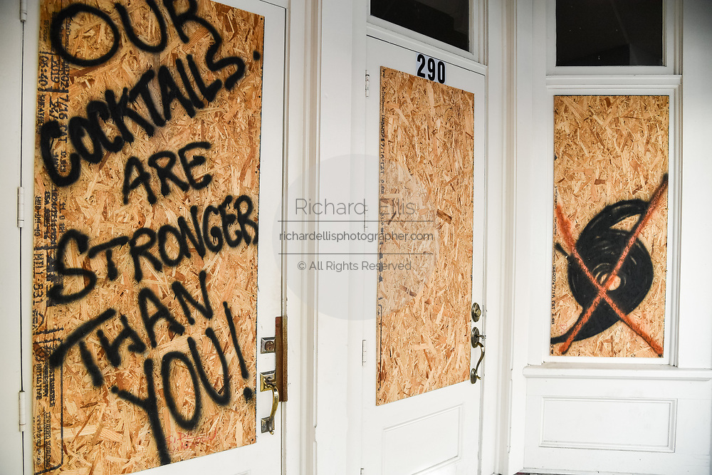 Charleston, South Carolina, USA. 03 September 2019. A boarded up shop on King Street in the historic downtown with witty slogans in preparation for Hurricane Dorian September 3, 2019 in Charleston, South Carolina. The slow moving monster storm devastated the Bahamas and is expected to reach Charleston as a Category 2 by Thursday morning.