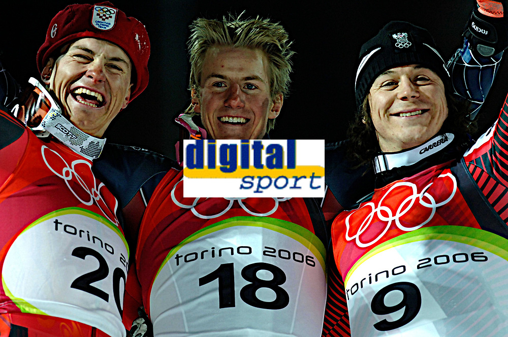 Photo: Catrine Gapper.<br /> Winter Olympics, Turin 2006. Alpine Skiing Men's Combined Slalom. 14/02/2006. The Mens Combined Slalom medalists (silver, gold and bronze from left to right).