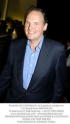 The EARL OF DARTMOUTH  at a party in London on 11th September 2003.PMI 261