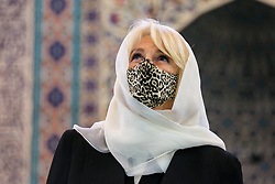 © Licensed to London News Pictures. 07/04/2021. London, UK. Camilla, Duchess of Cornwall, wearing a protective face covering and headscarf, looks around the Prayer Hall  during a visit to the London Islamic Cultural Society and Mosque (also known as Wightman Road Mosque) in Haringey, north London. The Mosque was formed by a small group of Guyanese Muslims and now supports over 30 different nationalities and community in Haringey and surrounding boroughs. Photo credit: Dinendra Haria/LNP
