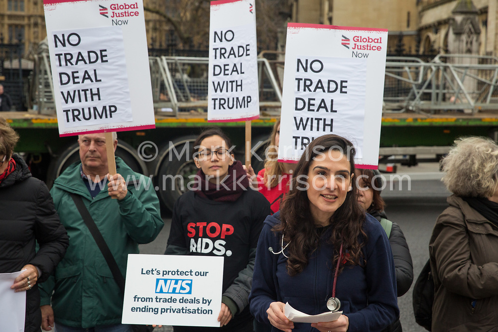 London, UK. 25 November, 2019. A NHS doctor from Oxford addresses campaigners from Keep Our NHS Public, Health Campaigns Together, We Own It and Global Justice Now at a protest in Parliament Square to call on Prime Minister Boris Johnson to end privatisation of healthcare in the National Health Service (NHS).
