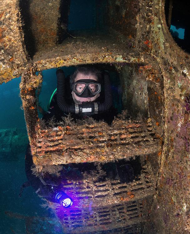 KISS rebreather scuba diver behind the ladder on USCGC Spar Shipwreck<br /> in North Carolina, USA