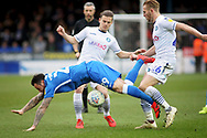 Peterborough Utd's Lee Tomlin (29) is fouled by Wycombe defender Jason McCarthy (26) during the EFL Sky Bet League 1 match between Peterborough United and Wycombe Wanderers at London Road, Peterborough, England on 2 March 2019.