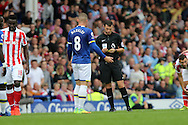 Ross Barkley of Everton receives a yellow card from referee Michael Oliver. Premier league match, Everton v Stoke city at Goodison Park in Liverpool, Merseyside on Saturday 27th August 2016.<br /> pic by Chris Stading, Andrew Orchard sports photography.