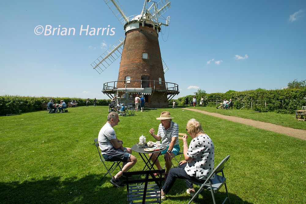 Thaxted Essex UK 31 May 2021 Bank Holiday Summer tea and cake in the grounds of John Webbs Windmill (Thaxted Windmill).<br />quintessential British summer scene. Enjoying the summer sun and tea and cake from the Giddy Up Bar and Teacup in the grounds of John Webbs Windmill in Thaxted northwest Essex. Photograph Brian Harris