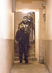 Police leave a flat in Stirling. Police take part in an operation against drug dealers in the Stirling area early this morning.