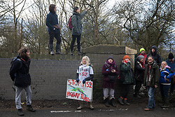 Harefield, UK. 17 January, 2020. Activists from Stop HS2 and Extinction Rebellion stand in front of woodland expected to be destroyed this weekend by HS2 at the beginning of a three-day 'Stand for the Trees' protest in the Colne Valley timed to coincide with the tree felling work. 108 ancient woodlands are set to be destroyed by the high-speed rail link.