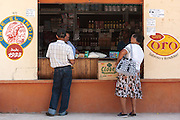 Customers shop at a food store in the town of San Esteban, Honduras on Wednesday April 24, 2013.