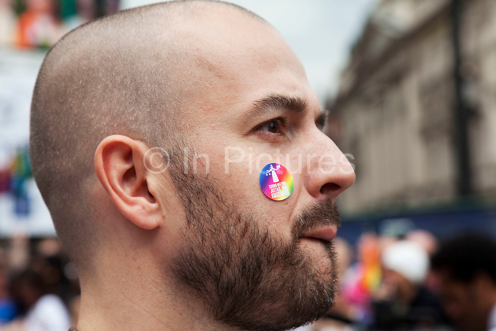 Man with a sticker on his face which reads 'Sound off for justice.org'. Pride London gay and lesbian parade through central London. Pride London (founded in 2004) aims to promote equality and diversity through all of its campaigns. The Pride London festival uses theatre, music, debate, art and entertainment to raise awareness of discrimination and the issues and difficulties affecting the lives of lesbian gay bisexual and transgender people around the world. The annual parade is an explosion of Pride in the heart of the capital, attracting over 1,000,000 people in a celebration of diversity.