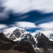 A ninety second exposure using ND filters of the clouds and enormous peaks of Siula Grande (high right at 6344 Meters) and Carnicero (high middle and closer at 5960 Meters). Siula was made famous my the Touching the Void film.