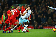 Michail Antonio of West Ham United tries to get away from Jordan Henderson of Liverpool. Premier League match, Liverpool v West Ham Utd at the Anfield stadium in Liverpool, Merseyside on Sunday 11th December 2016.<br /> pic by Chris Stading, Andrew Orchard sports photography.