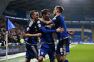 Joe Mason of Cardiff city © celebrates with his teammates Craig Noone (l) and Joe Ralls (r) after he scores his teams 1st goal. Skybet football league championship match, Cardiff city v Blackburn Rovers at the Cardiff city stadium in Cardiff, South Wales on Saturday 2nd Jan 2016.<br /> pic by Andrew Orchard, Andrew Orchard sports photography.