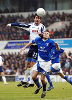 Photo: Chris Ratcliffe.<br />Ipswich Town v Portsmouth. The FA Cup. 07/01/2006.<br />Ian Westlake (R) of Ipswich battles it out with Richard Hughes.