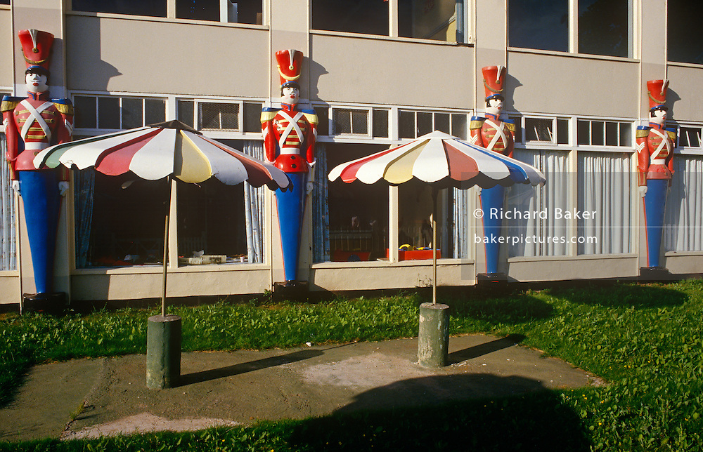 Original soldier sentry statues that adorn the wall of an old building at the regenerated Butlins holiday centre at Minehead.