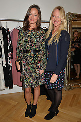 Left to right, PIPPA MIDDLETON and ROSIE NIXON at a party to celebrate the opening of the first Tabitha Webb Retail Store at 45 Elizabeth Street, London on 23rd September 2014.