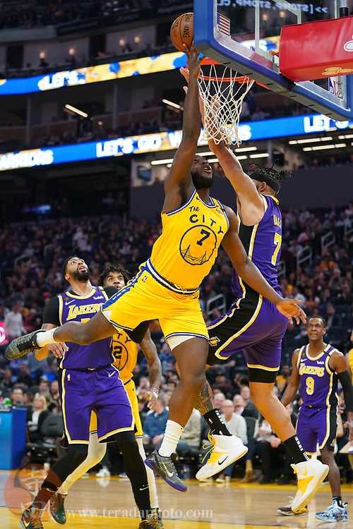 February 27, 2020; San Francisco, California, USA; Golden State Warriors forward Eric Paschall (7) shoots the basketball against Los Angeles Lakers center JaVale McGee (7) during the third quarter at Chase Center.