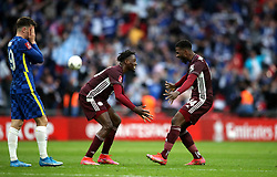 Leicester City's Wilfred Ndidi (centre) and Kelechi Iheanacho celebrate while Chelsea's Mason Mount looks dejected after the Emirates FA Cup Final at Wembley Stadium, London. Picture date: Saturday May 15, 2021.