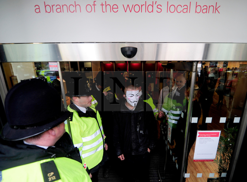 © Licensed to London News Pictures. 15/05/2012. London,Britain. Members of the Occupy London Stock Exchange group protest against against the finance industry in front of a branch of HSBC Bank in central London on May 15, 2012 . Photo credit : Thomas Campean/LNP