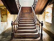 17 MARCH 2015 - BANGKOK, THAILAND: A stairwell in the old Customs House in Bangkok. The old Customs House was once the financial gateway to Thailand (before 1932 called Siam). It was designed by an Italian architect in the 1880s. In the 1950s, customs moved to new, more modern building and the Customs House became the headquarters for the Marine firefighters. The firefighters now live in the decrepit buildings with their families.    PHOTO BY JACK KURTZ