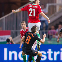 Netherlands' Kevin Strootman (bottom) and Hungary's Zsolt Korcsmar (top) finght for the ball during the World Cup 2014 qualifying soccer match Hungary playing against Netherlands in Budapest, Hungary on September 11, 2012. ATTILA VOLGYI