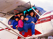 Super Cub stuffing contest in Andy Greenblatt's PA18 with nine, count 'em, people inside, Bettles Field, Alaska.