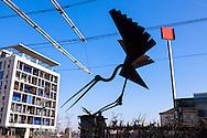 """Europa, Deutschland, Nordrhein-Westfalen, Koeln, Skulptur """"Landender Storch"""" am Ubierring Ecke Rheinuferstrasse am Rheinauhafen.<br /><br />Europe, Germany, North Rhine-Westphalia, Cologne, sculpture """"Landing Stork"""" at the street Ubrierring corner Rheinufer street near Rheinau harbor."""