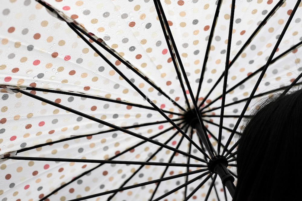 keeping dry under umbrella